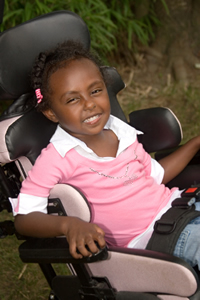 Smiling Girl in Wheel Chair